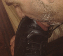Faggot slave licks a boot